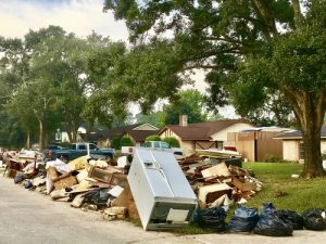 air conditioners flooded in thousands of homes in Houston during Hurricane Harvey flood debris piles on residential street