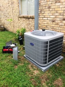 residential air conditioning repair unit being serviced